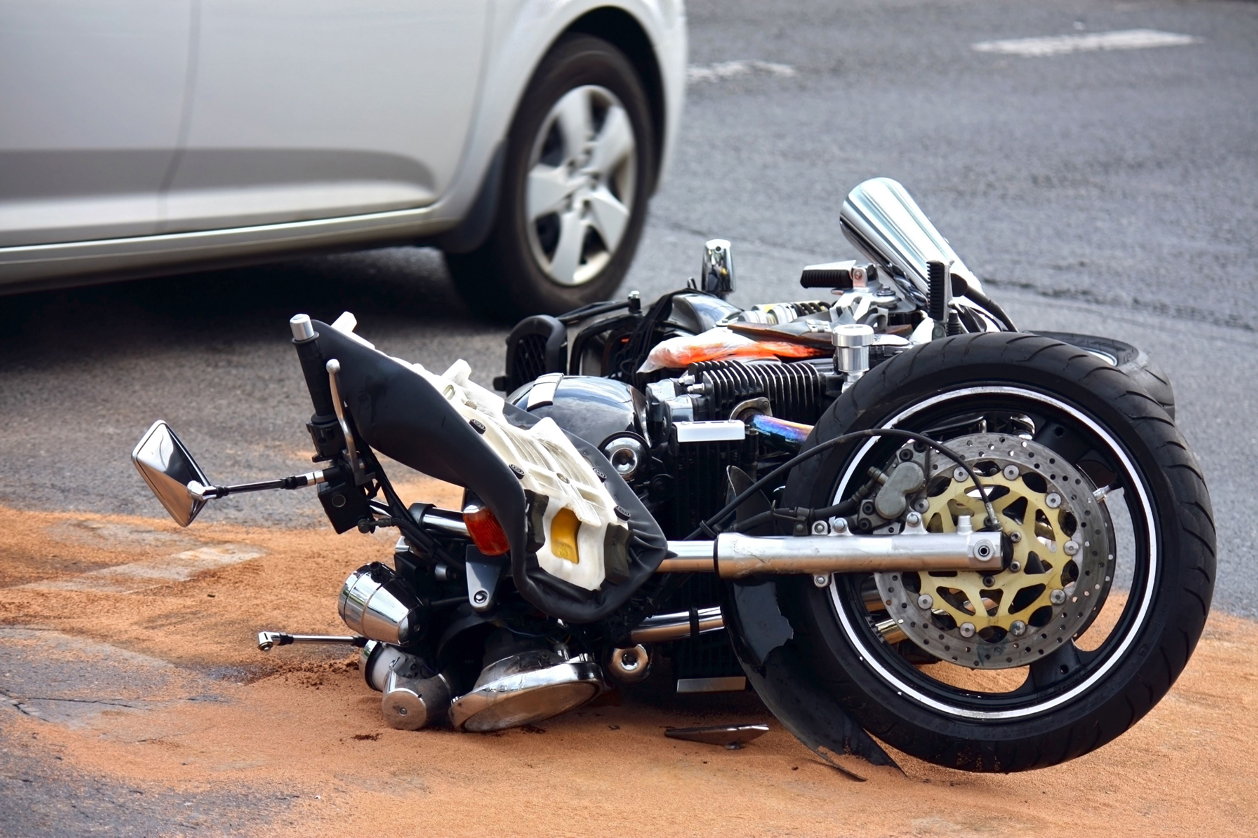 Motorcycle laying on the road after an accident